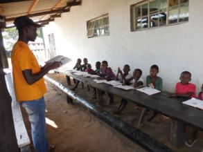 Mbuso tutoring first grader pre-school graduates