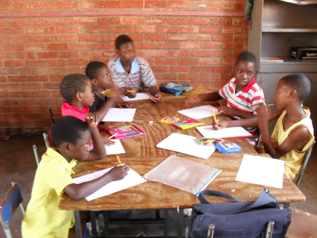 Zimkids working on wall mural designs