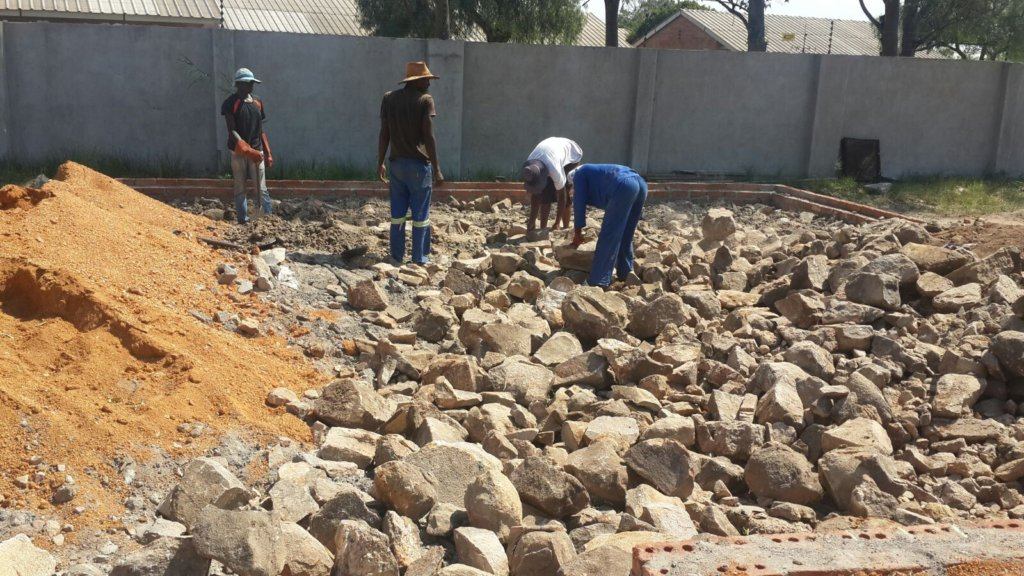 Filling the foundation with rock & rubble