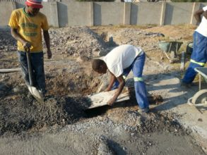 Hand mixed gravel, sand & cement poured for base