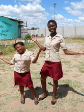 Lindiwe and Charity model the uniforms they made