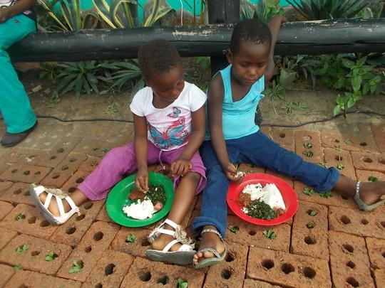 Pauline supervises kitchen &kids enjoy the results