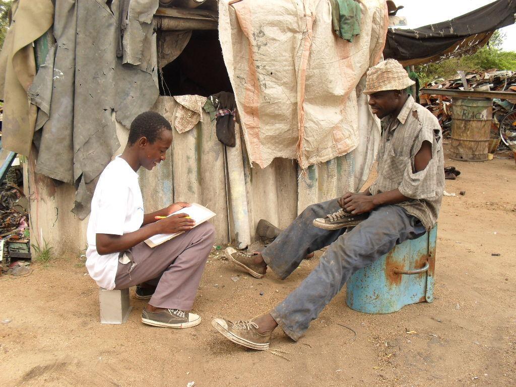 Elder Collen interviewing squatter at dump