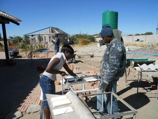 Sithibisiwe cutting tiles for bathrooms