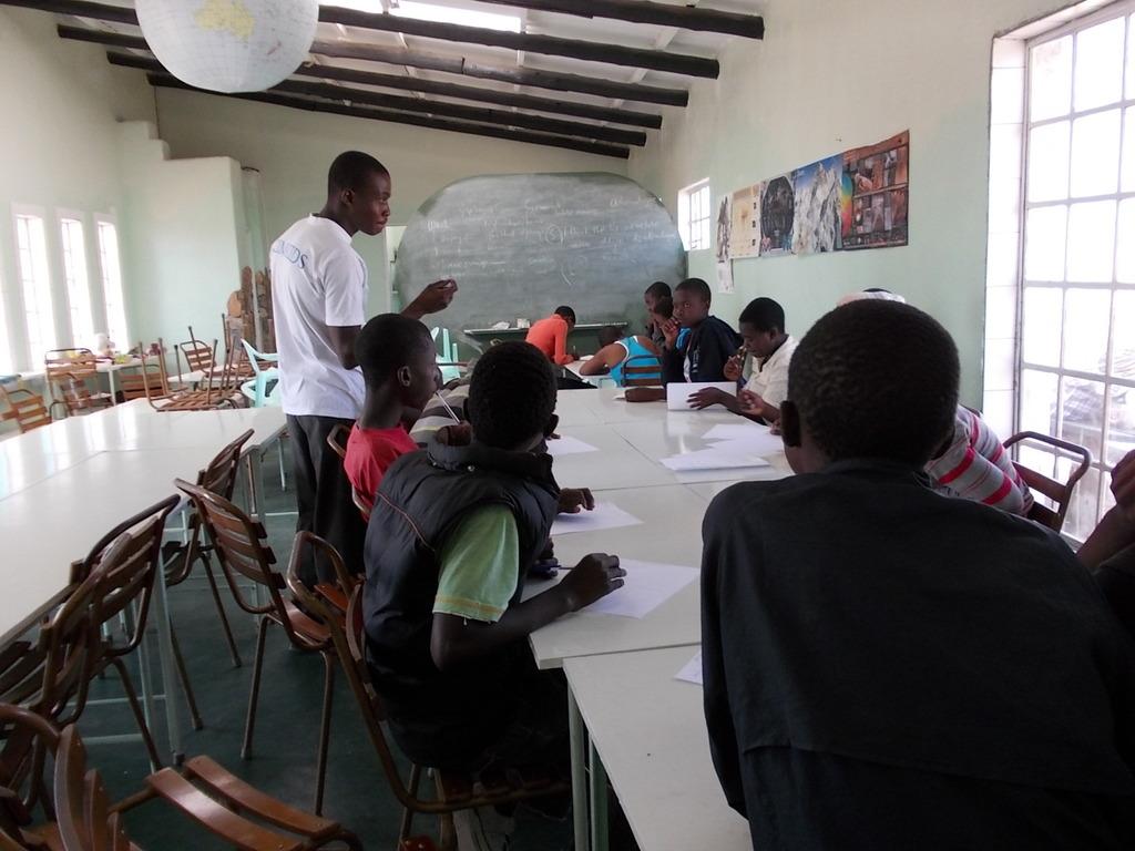 Washie tutoring English in new resource center