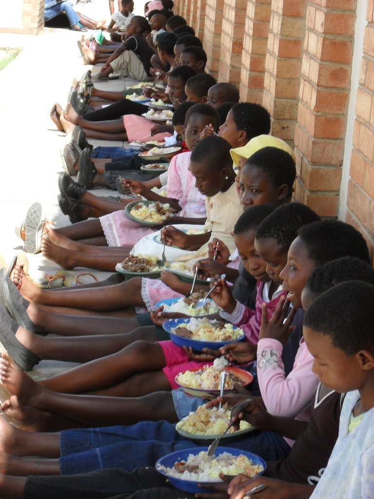 Along with our monthly food distributions for caregivers and our orphans we have special days where the children present their talented drama, dance routines, artwork and poetry to their families. We provide meals on site on these occasions