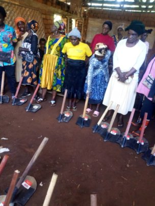JRCCA Donated   hoes to Farmers in Toneku Village