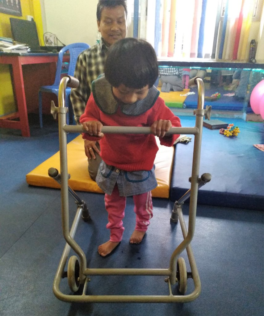 Radhika* learning to walk with a rollator