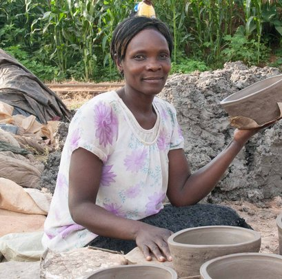 Returnee making clay stove to make a living