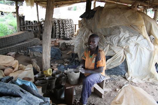production facility clay wood stove