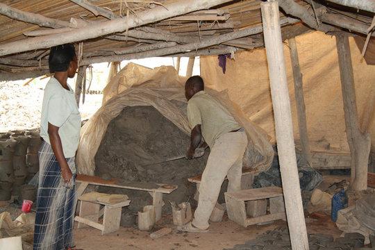 Preparing soil for making clay wood stove