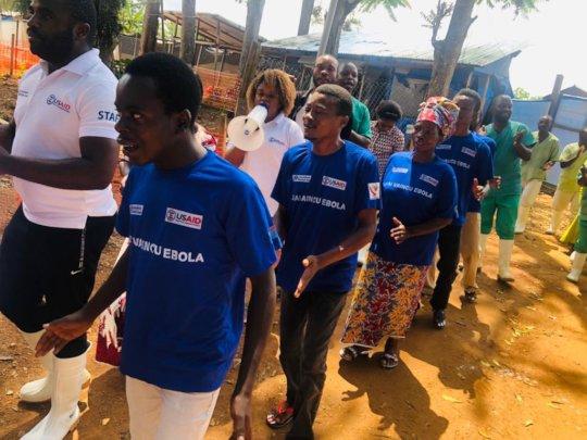 Ebola survivors leaving the treatment facility.
