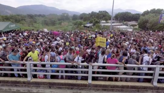 Venezuelan Refugees Crossing Bridge into Colombia