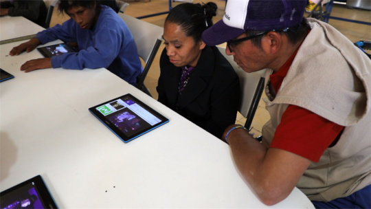 Adults learning with tablets