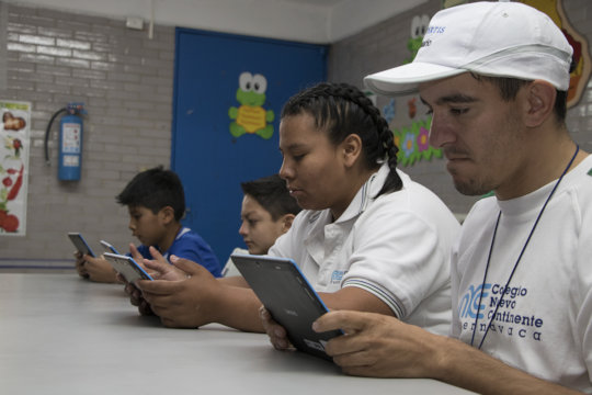 Benficiaries working with tablets