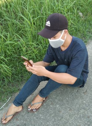 Downloading class materials in the rice field