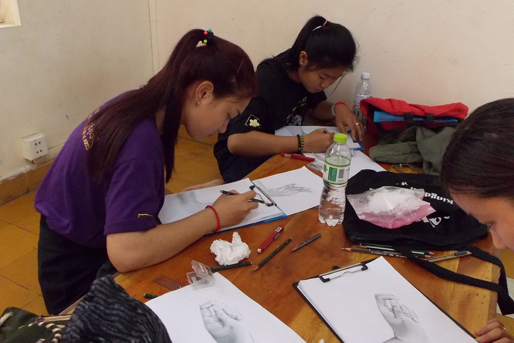 Students practice drawings of dancer