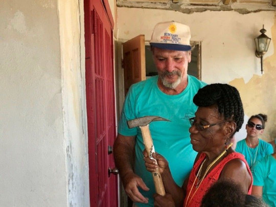 St. Thomas Recovery Team celebrates a new home