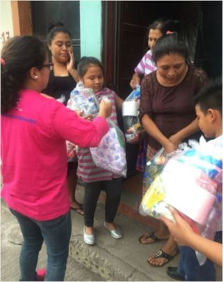ASOGEN staff & volunteers deliver relief items.
