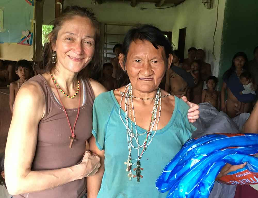 Eglee celebrates with a community elder in Iguana