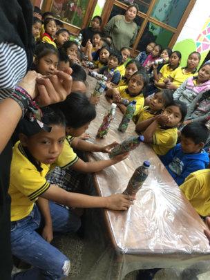 Children making eco-bricks