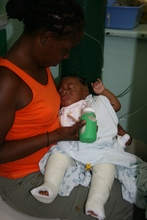 Briandel with his mother following surgery