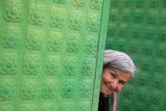 Fatime at the gate of her daughter's house