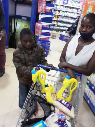Eunice and her mother getting their shopping
