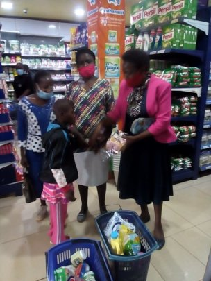 Teacher food shopping with the families