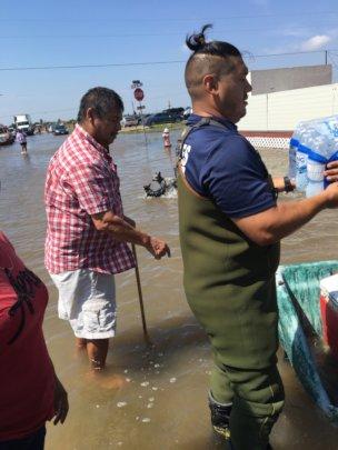 Distributing water to flood survivors.
