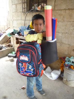 Estuardo with His School Supplies
