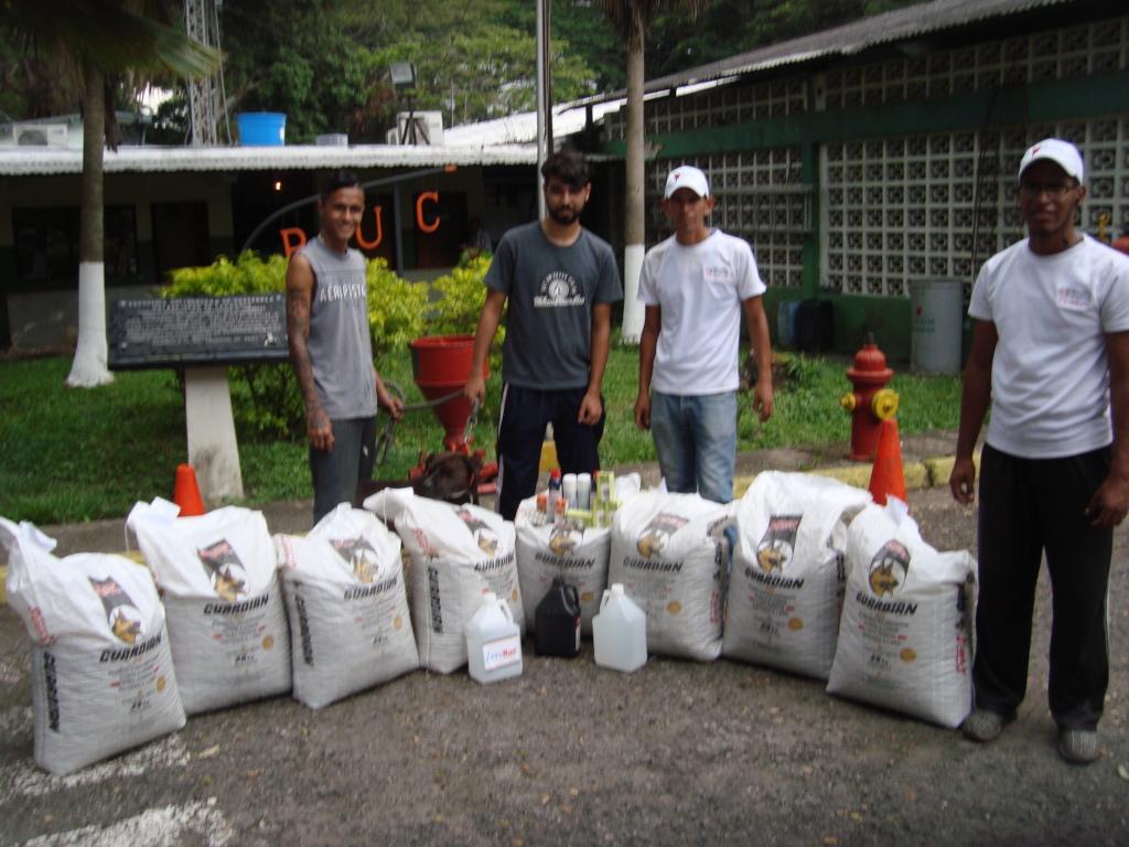 SAI delivers 8 bags of dog food & meds to shelter