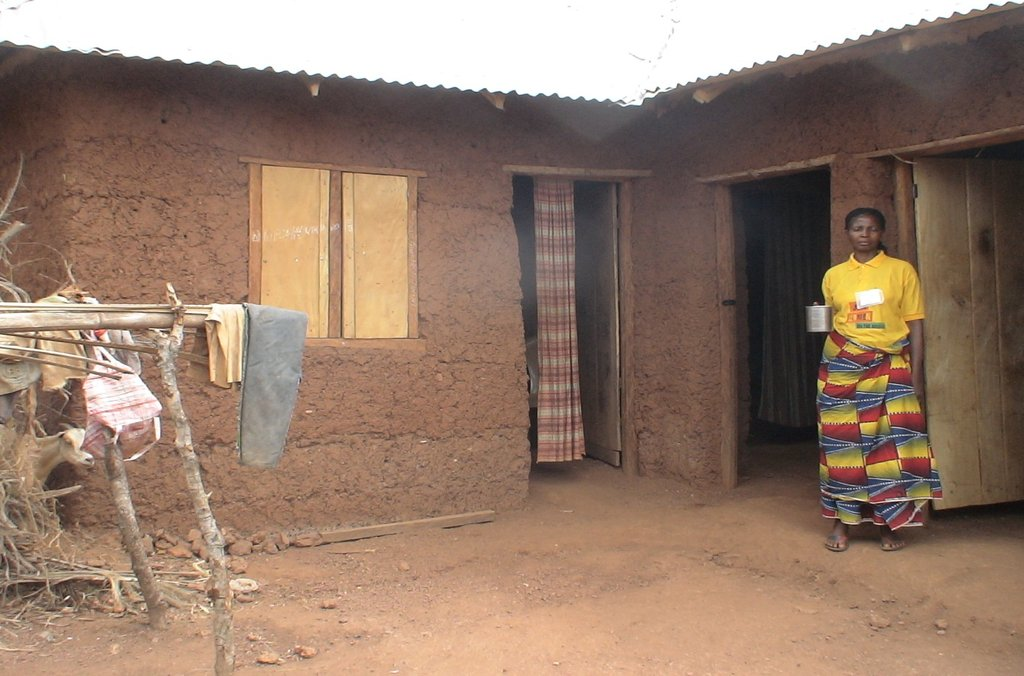 Roseline in front of her house.