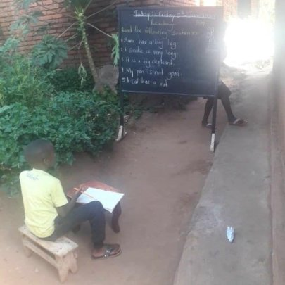 One of the older students learning outside