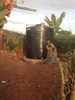 Mom at her water tank