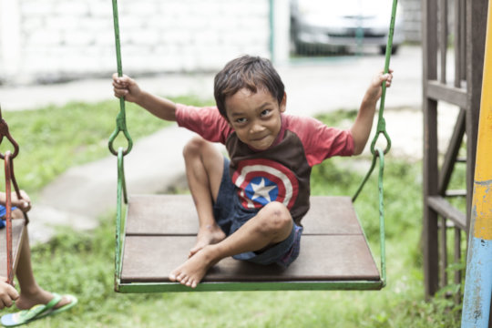 A boy play at the centre playground