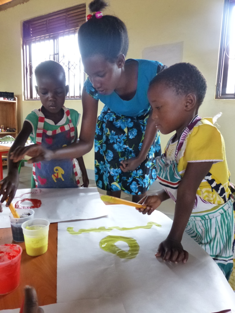 Grace encourges children to be creative with paint