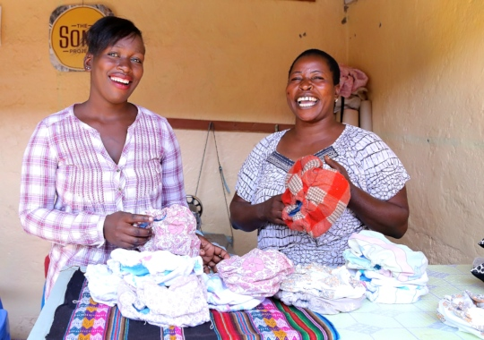 Hilda and a customer at Hidaya Diapers