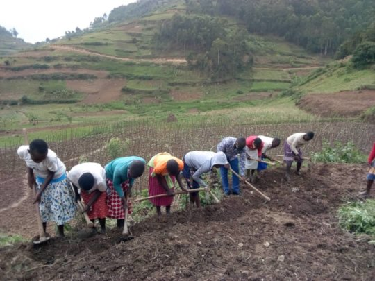 Girl's in Our Empowerment Program Planting Beans