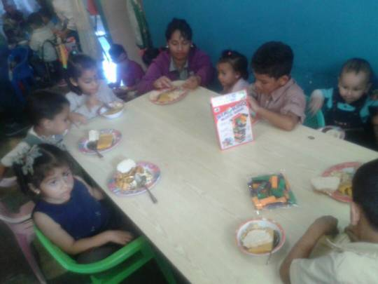 Children having Hallacas at the Christmas event