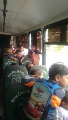 Children in the shuttle going to the movie theater