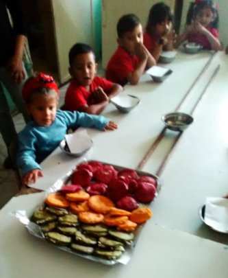 Children at the preschool eating enriched arepas