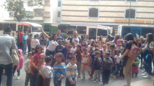 A group of Children w/ chaperones at the theater