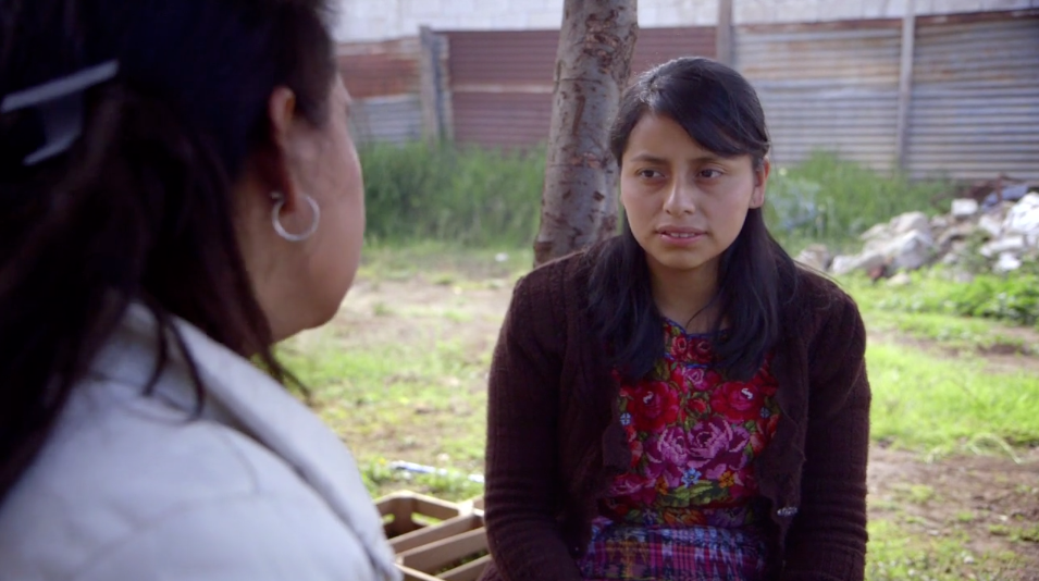 Nurse Sandy speaks with patients in Kaqchikel Maya