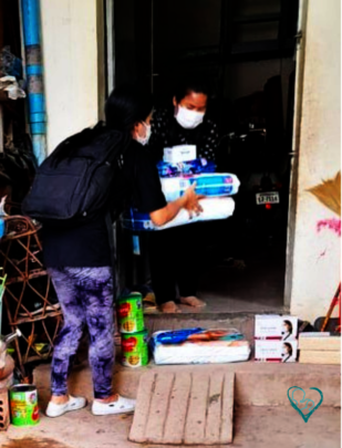 MH foster mother receiving milk and food supplies.