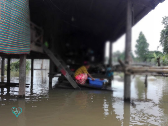 Closer view of a house in floodwater.