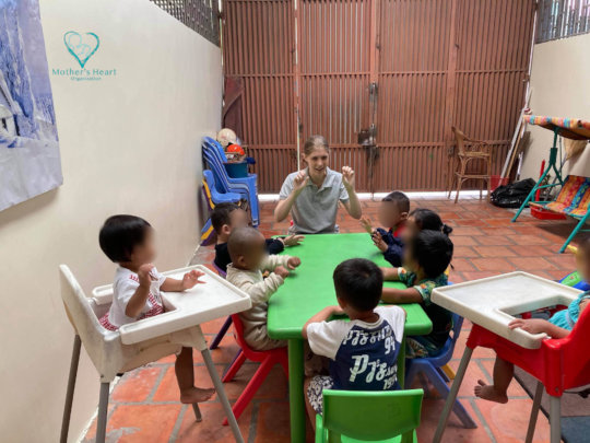 Children in the daycare enjoy listening to a story