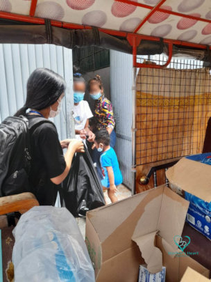MH social worker distributing food support.