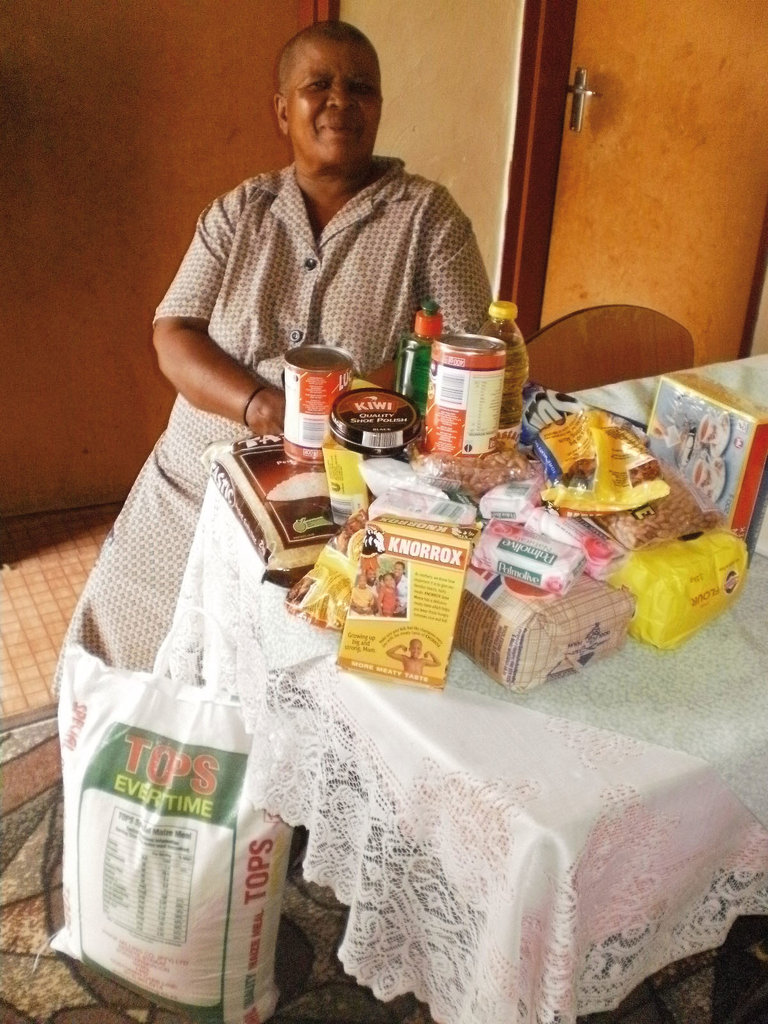 Gogo Mary with the Topsy OVC food parcel