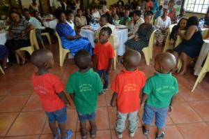 Kids from a local day care centre sang for guests